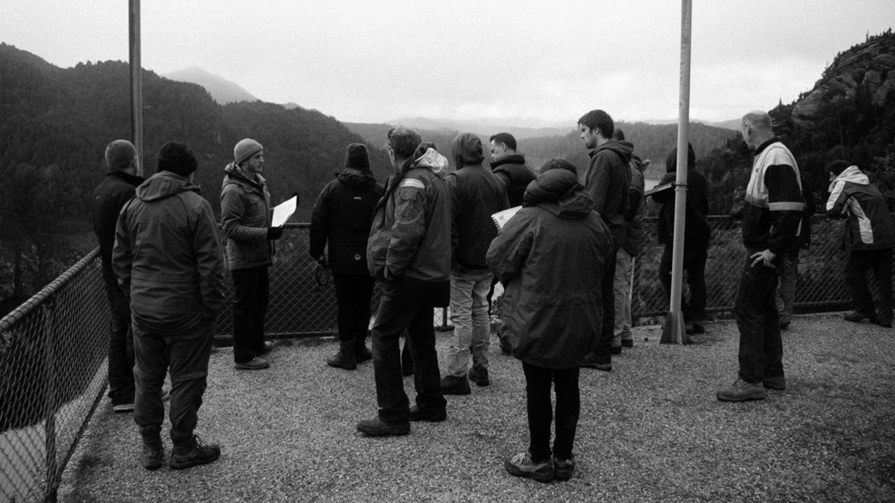 Director Tom Noakes speaks with crew members during a shoot at Gordon Dam in Tasmania.