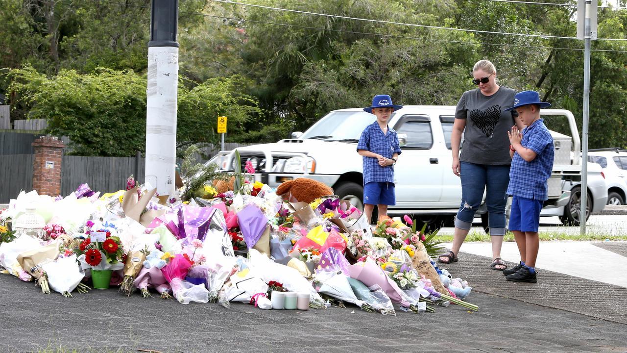 Mourners at the scene of the fatal crash. Picture: Steve Pohlner