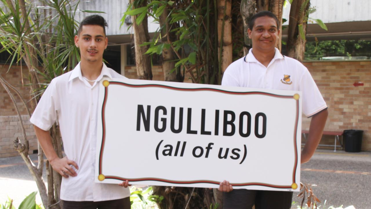 EMBRACING CULTURE: Lismore High School Aboriginal leaders and prefects Year 12 students John Gibson and Jaidyn Cicchinelli hold one of the new signs for the building block renaming project which sees all the campus buildings renamed in broader Bundjalung language. Photo: Alison Paterson