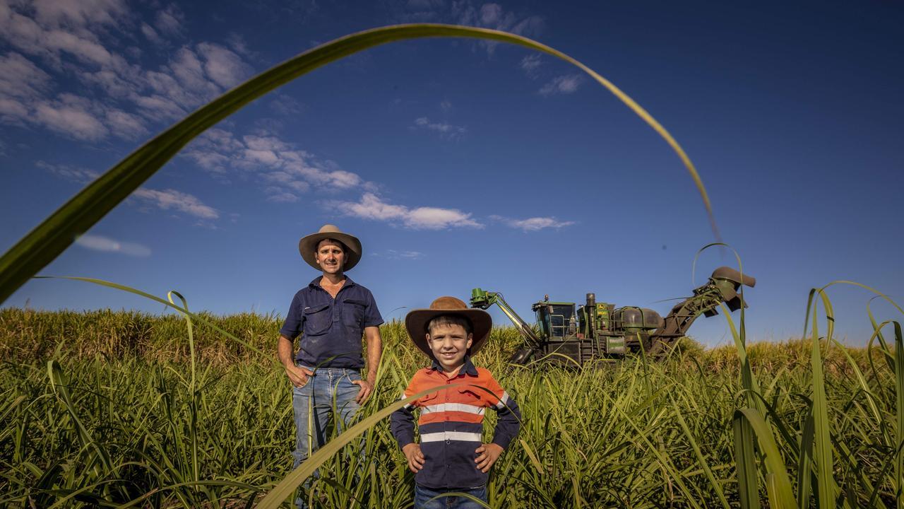 Farmer Charles Quagliata with his son on their sugar cane farm in Queensland. Photo: Glenn Hunt / The Australian