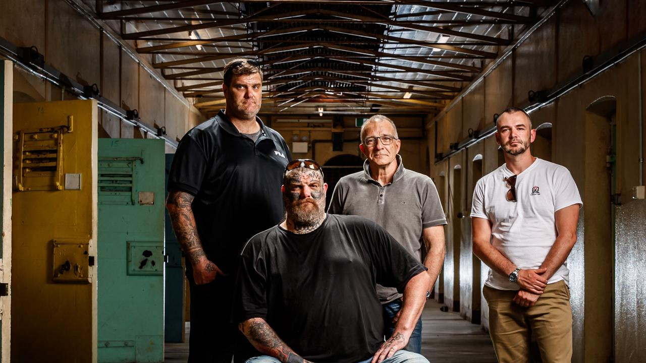 Former Finks MC members Matt and Tyson Ward (sitting), Henry Keogh and Arcofyre Founder and CEO Kirby Brownlow at the old Adelaide Gaol in 2020. Picture Matt Turner.
