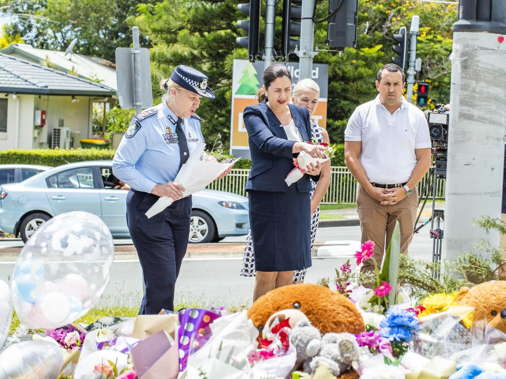 Queensland Premier Annastacia Palaszczuk and Queensland Police Service Commissioner Katarina Carroll lay flowers for Kate Leadbetter and Matty Field. Picture: Richard Walker