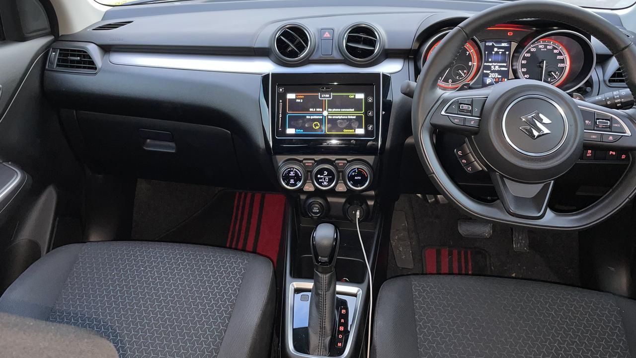Inside the 2020 model Suzuki Swift Turbo GLX is basic but functional.