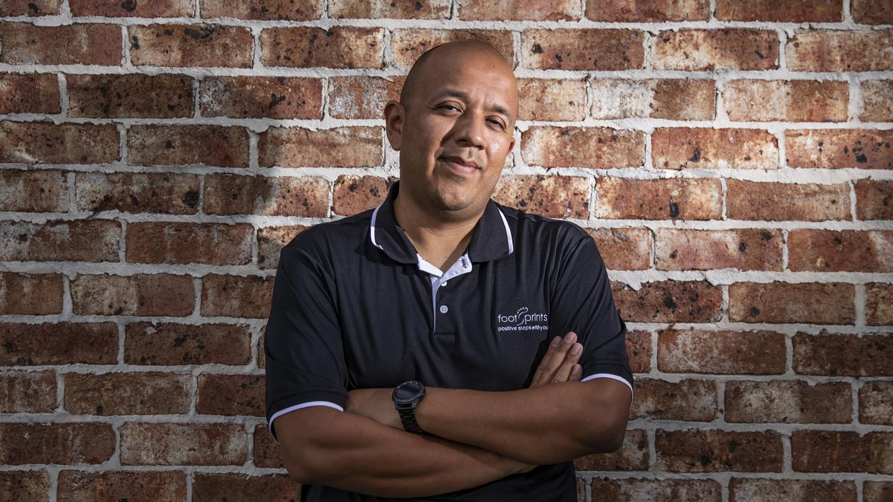 Footprints case manager Jorge Ayala, 39, is in charge of Assistance in Care and Housing programs, dealing with decluttering. Picture: Mark Cranitch