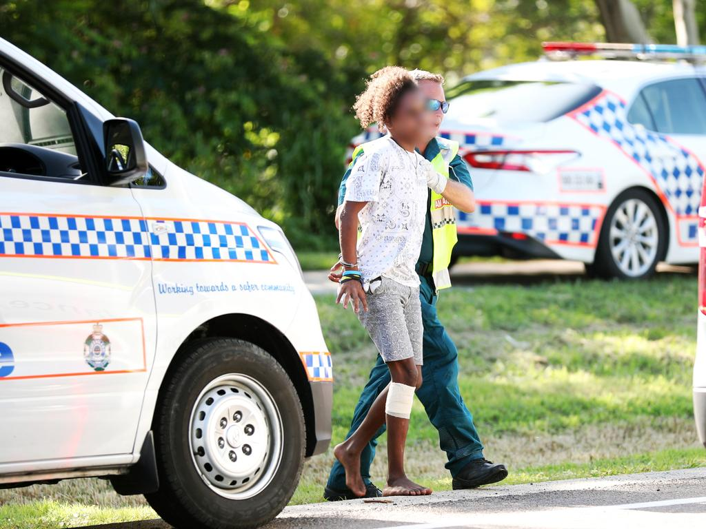 One of the young people allegedly in the stolen vehicle, being assisted by an ambulance officer. Picture: Alix Sweeney
