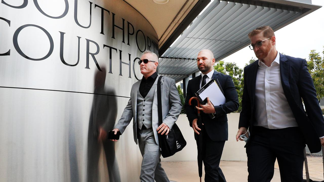 Jayden Moorea (left) arrives at Southport Magistrates Court with his legal team. Picture: Scott Powick.