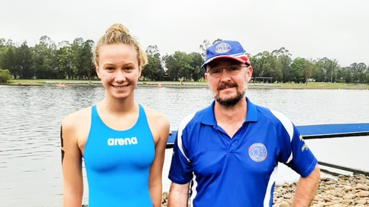 COACH'S TACTICS: Lismore Workers Swim Team athlete Abbie Yourell, 14, with coach Peter Harvey in Sydney. Abbie said his tactics helped her knock seven minutes off her 5km swim time.