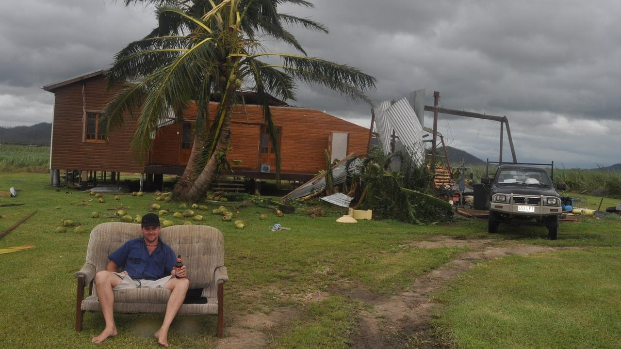 Severe Tropical Cyclone Yasi 2011. The aftermath, Mission Beach. Stuart McBeath who lives in East Feluga Rd near Mission Beach ended up taking refuge in his Hilux during Cyclone Yasi. Stuart is seen sitting outside his unroofed home.