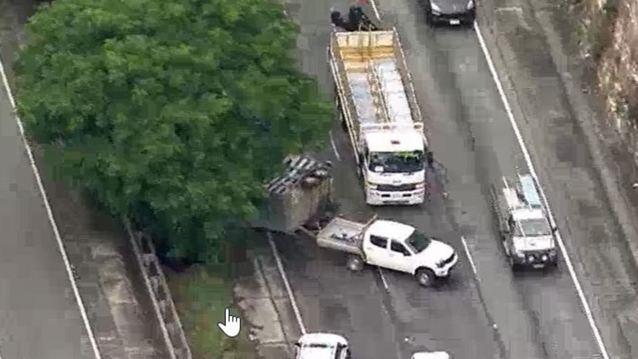 Major traffic delays were predicted by NSW Police after a bull was injured in a single-vehicle crash on the M1. Picture: 7 News