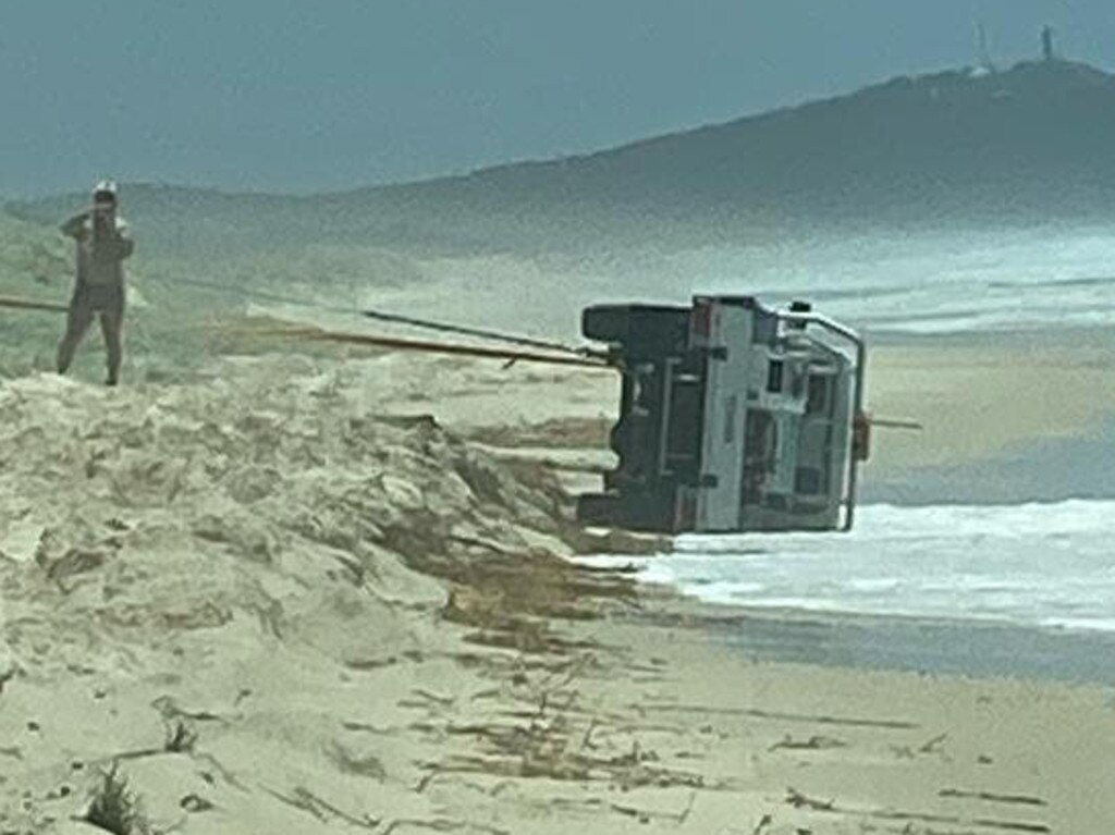A Toyota LandCruiser owned by QYAC was crashed on Moreton Island's main beach.