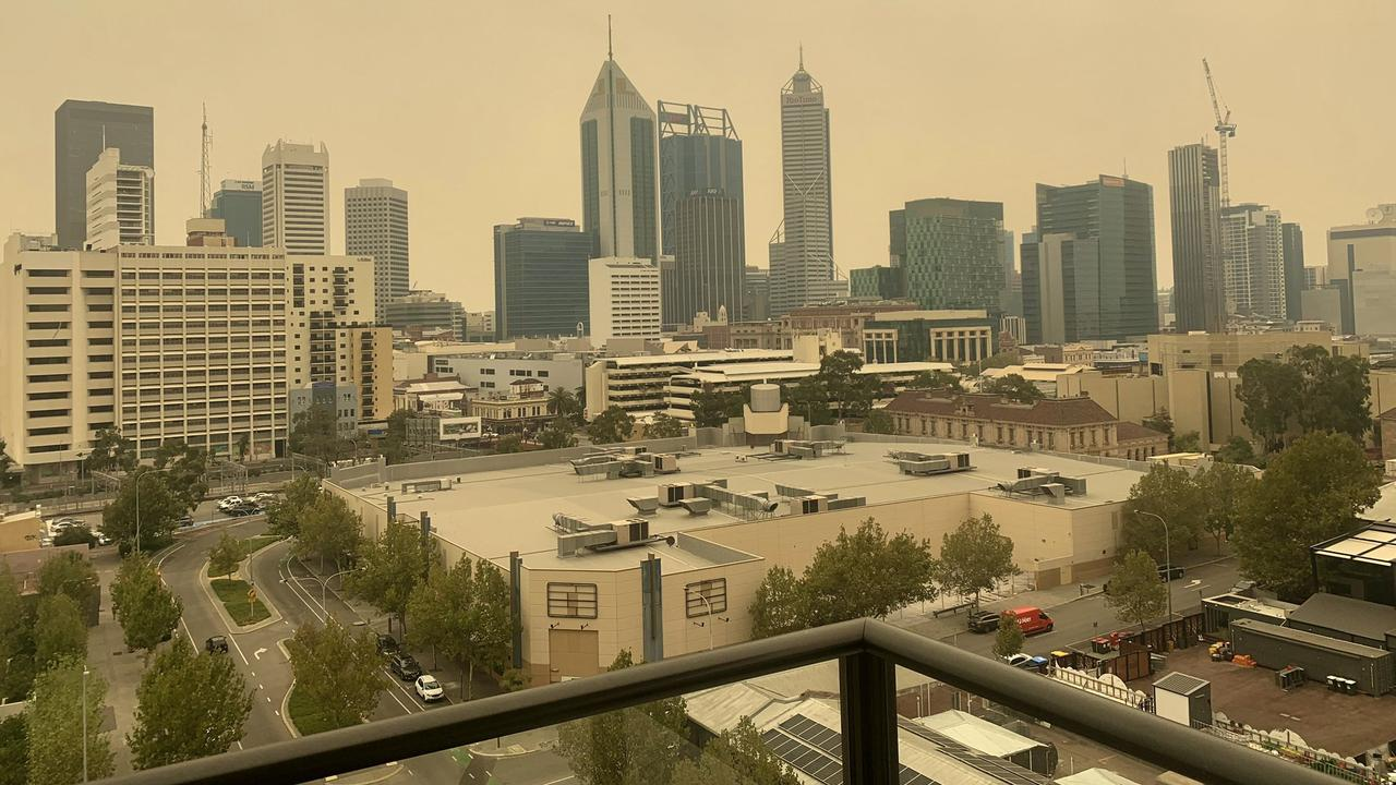 Ash and burnt leaves from the Perth Hills bushfire have been seen falling from the sky about 50km away.