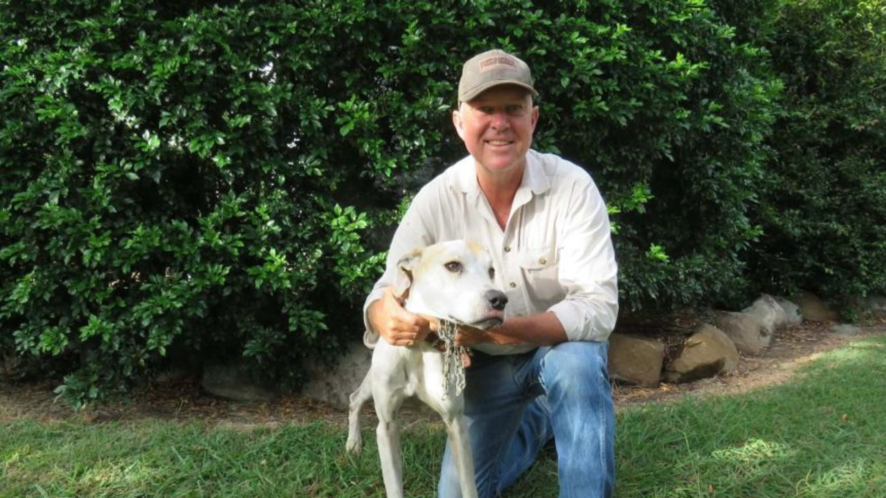 MP Tony Perrett with Robert Weber's beloved dog Nessie, who was missing for three weeks. Picture: Tony Perrett