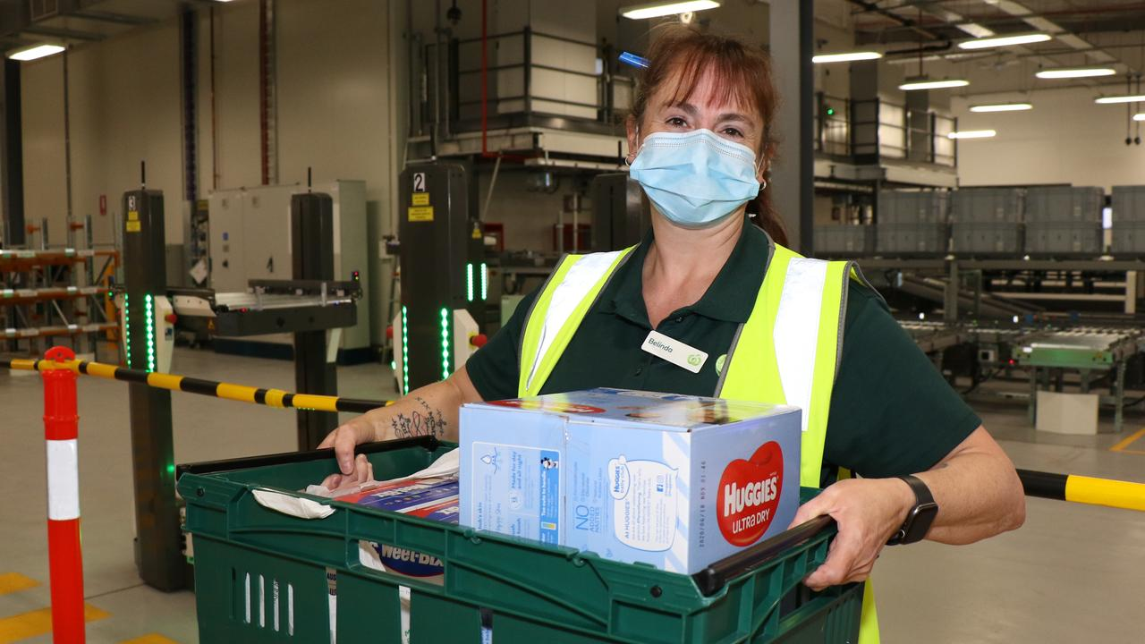 Woolworths Carrum Downs employee Belinda Victor at the Takeoff Technologies facility which helps improve speed and efficiency when packing online orders.