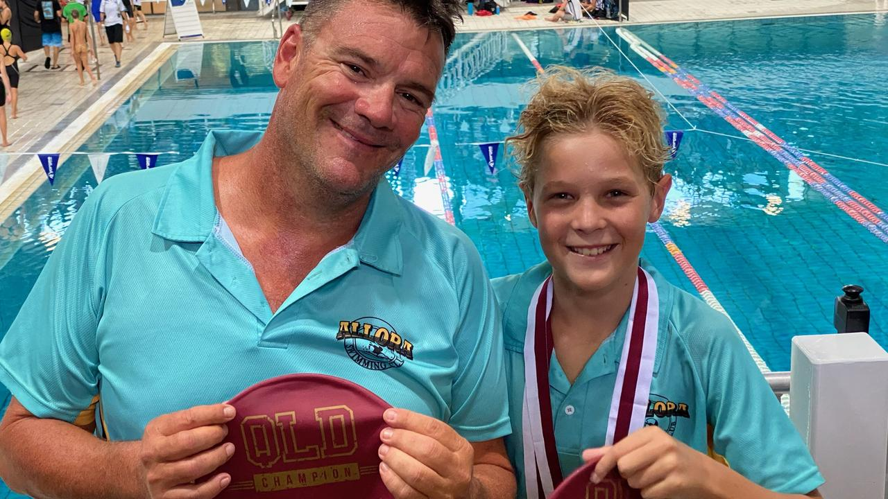 SWIMMING SENSATION: Bailey Harm with coach Andrew Fidge (left) and his three gold medals at last year's Sprint Championships.