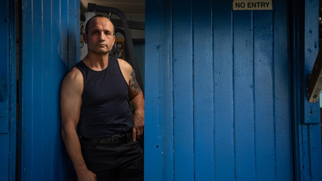 Jim Taousanis pictured at his gym in Scarborough, Queensland has written a book about his time in the Underbelly scene. Picture: Brad Fleet