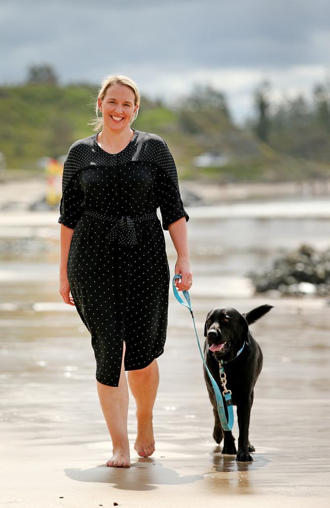 Deputy Director, Regional Development, North Coast, Department of Regional NSW Jillian Fryer walks her dog Frank on the beach in Port Macquarie. Pic Nathan Edwards