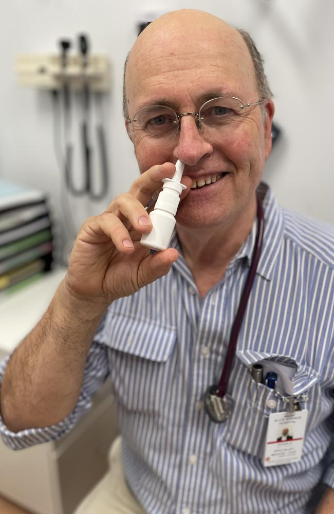 Professor Don Campbell taking a nasal spray that might help prevent catching coronavirus. Picture: Supplied.
