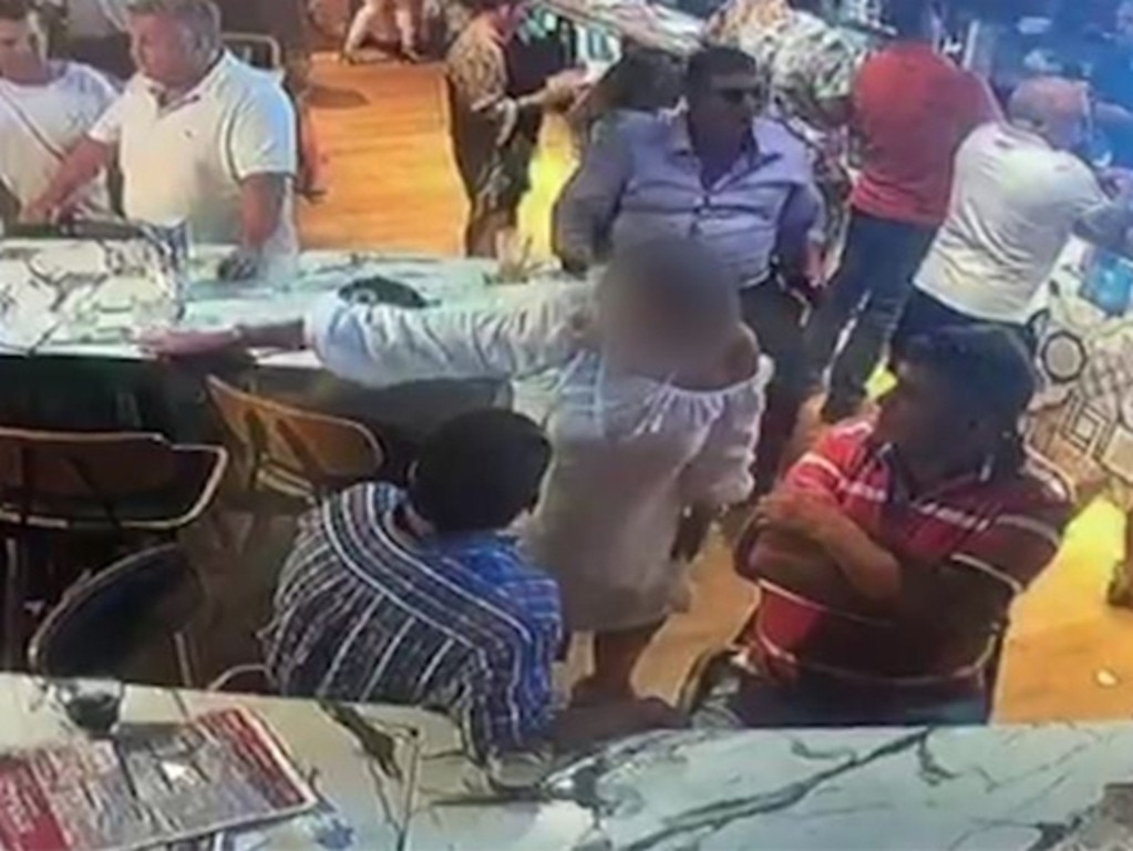 A prominent racing trainer has been involved in a confrontation with a woman after she slapped him for making contact with her.