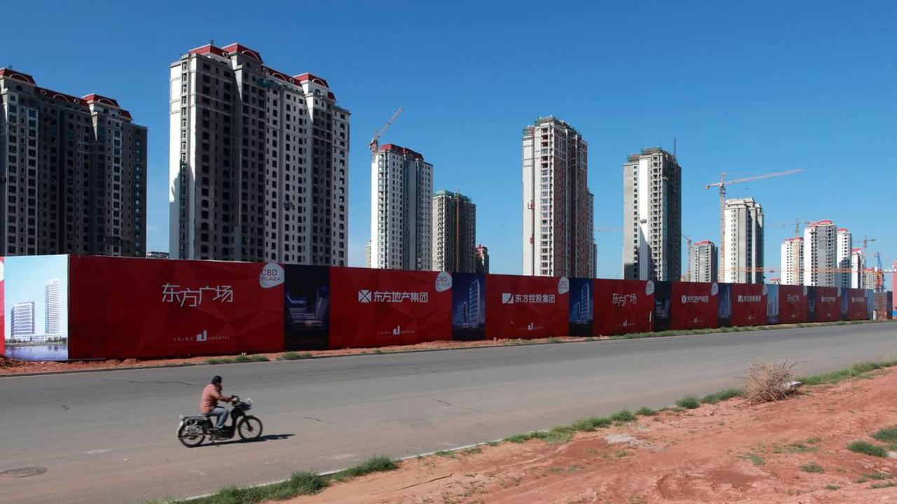 Densely packed apartment blocks under construction in the Kangbashi area of Ordos in 2011, when the district was less than 10 per cent occupied. Picture: Corbis/Getty