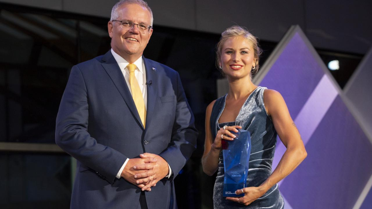 Prime Minister Scott Morrison with Australian of the Year Award winner Grace Tame. Picture: NCA NewsWire/Martin Ollman