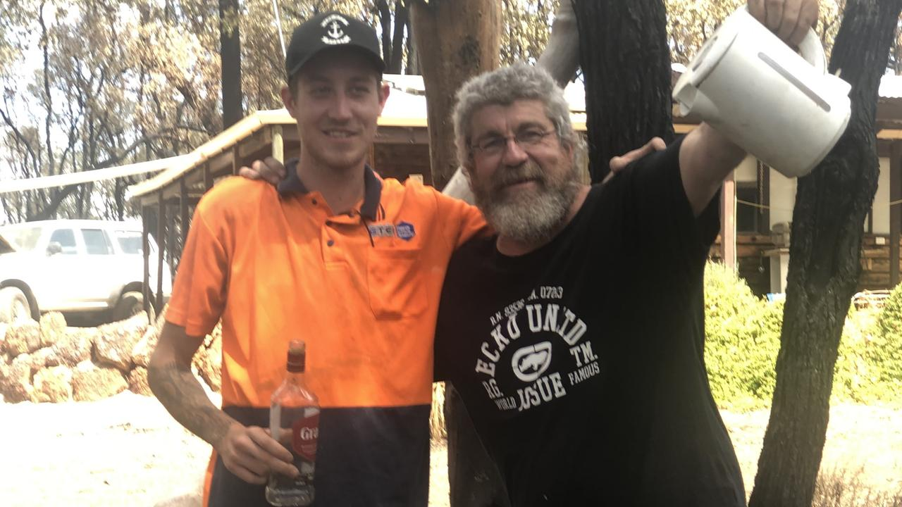 Steve Curtis and his son Danny managed to save their home from a bushfire using a kettle and a spirit bottle filled with water. Picture: Supplied by the family via NCA NewsWire