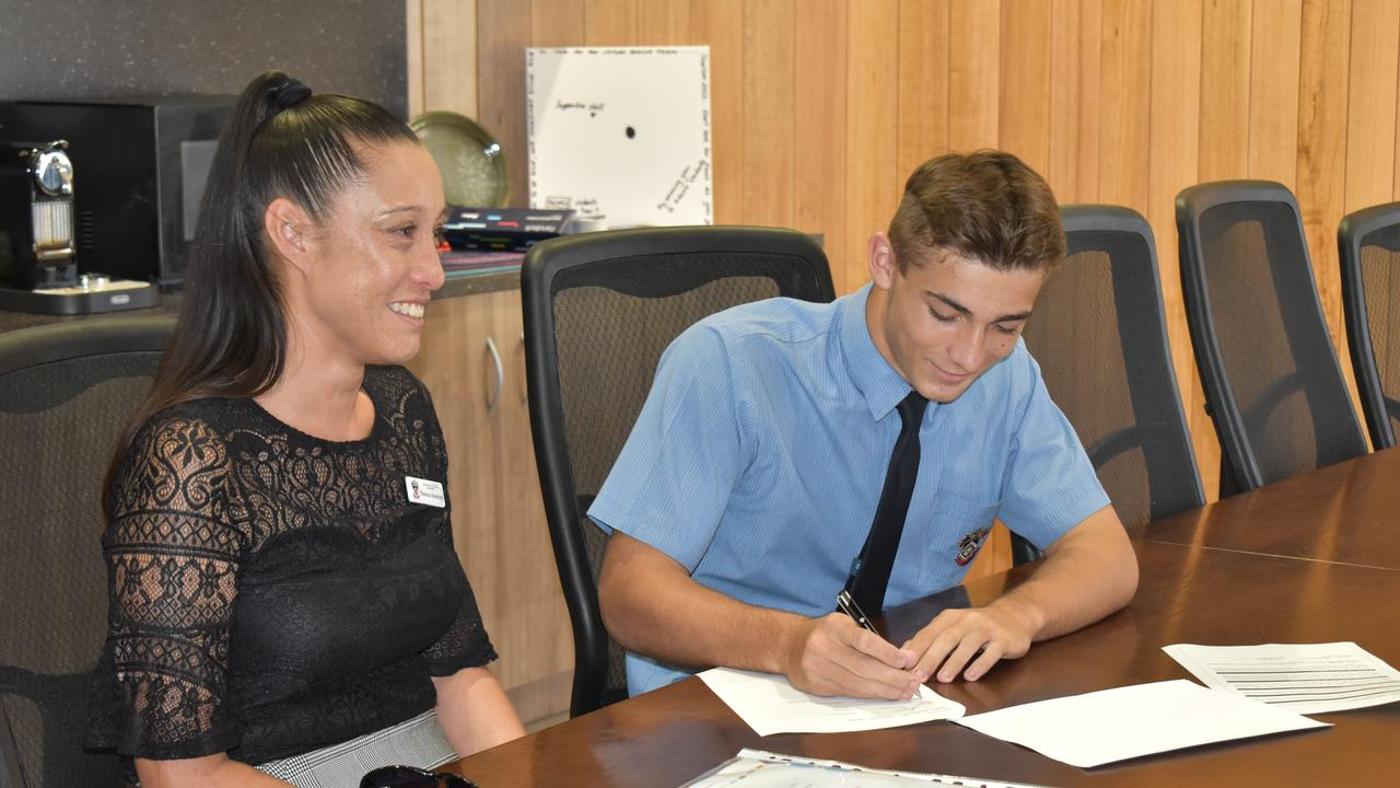Year 10 Shalom College student Thomas Morcom (pictured with his mum) has signed a three-year contract with the Brisbane Broncos Picture: Rhylea Millar.