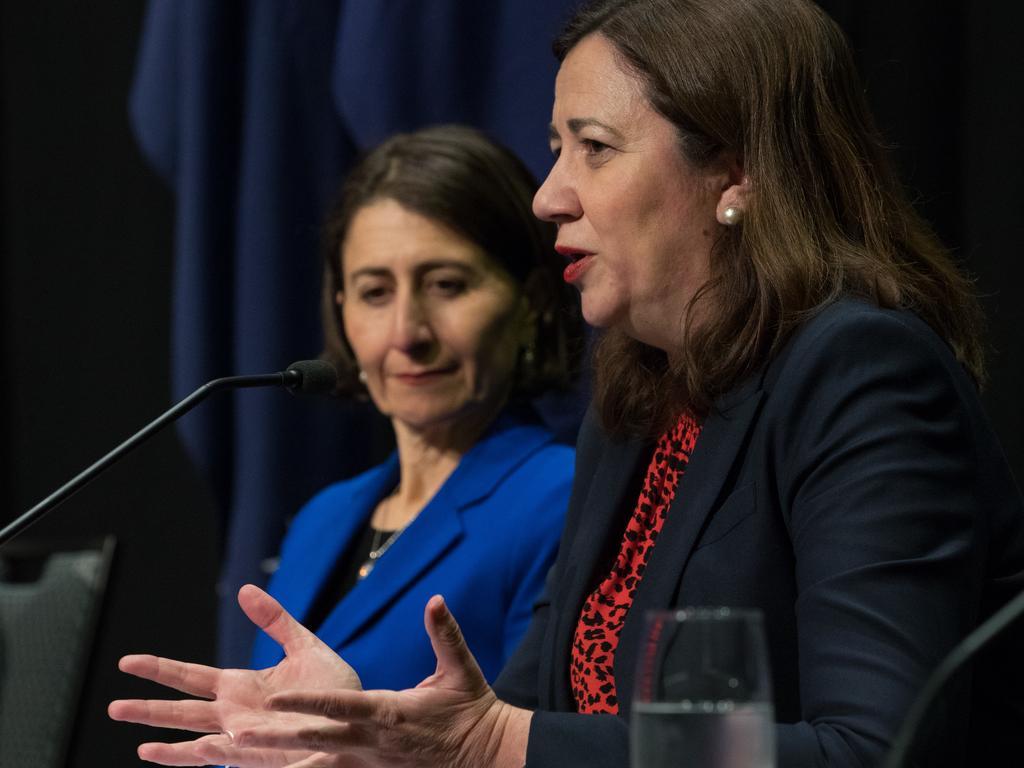 Queensland Premier Annastacia Palaszczuk speaks while her NSW counterpart Gladys Berejiklian looks on.