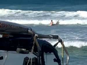 VIDEO: Moment man rescued from surf