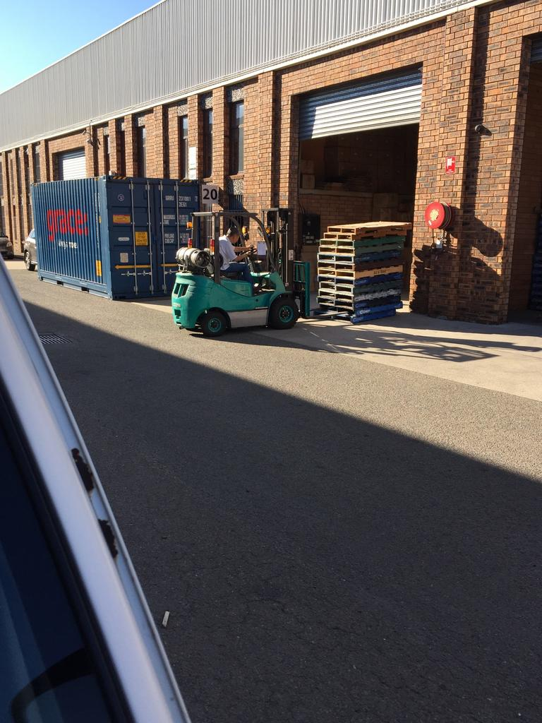 Wei Zhang unloads from a container delivered to Autong in Lansvale. Picture: PFM