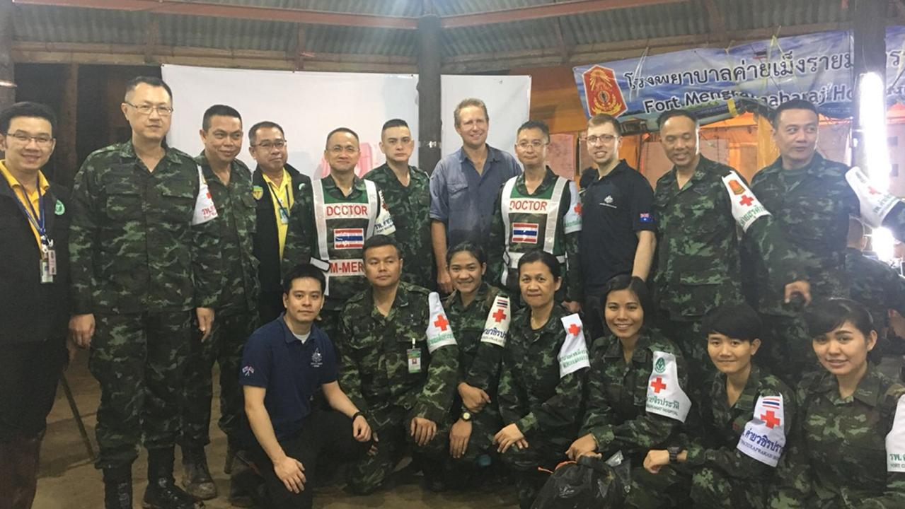 A supplied image obtained on Wednesday, July 11, 2018, of Australian doctor Richard Harris (centre), and the medical team he worked with to assist in the rescue of 12 Thai boys who were stuck in an underground cave with their soccer coach, but have since been rescued. (AAP Image/Supplied by DFAT)