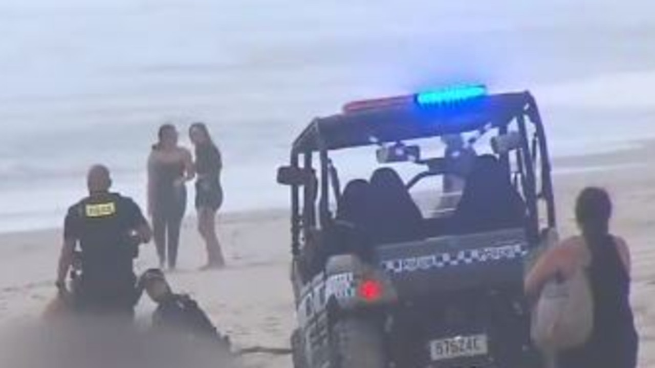 Emergency workers on the beach after a body was found at Main Beach. Picture: Channel 9.