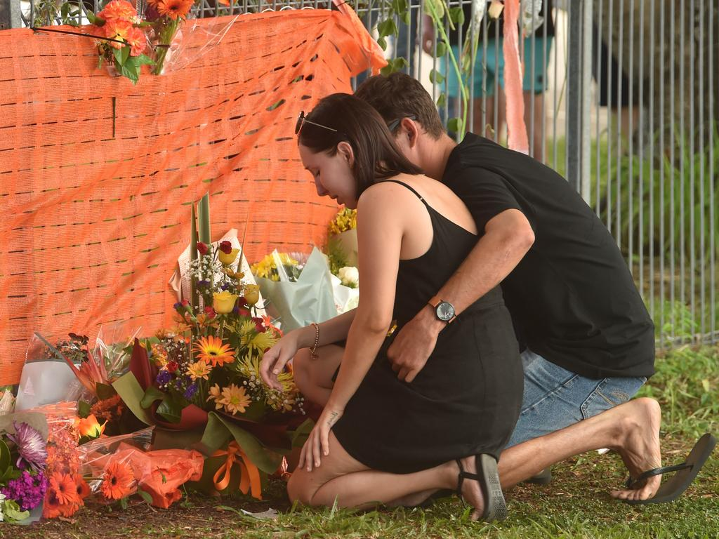 People place flowers near the accident site. Picture: Evan Morgan