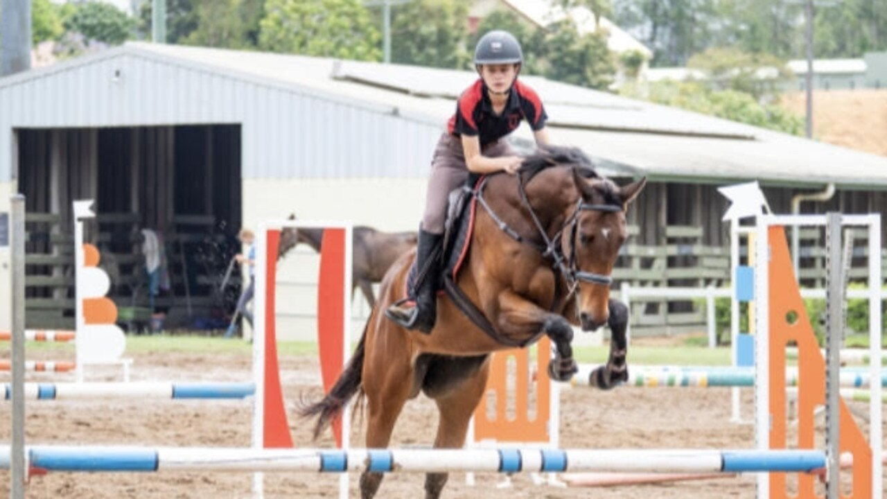 Kayla Johnston and her racehorse-turned-showjumper Pete.