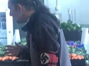 'Sickening': Man flaunts swastika at market