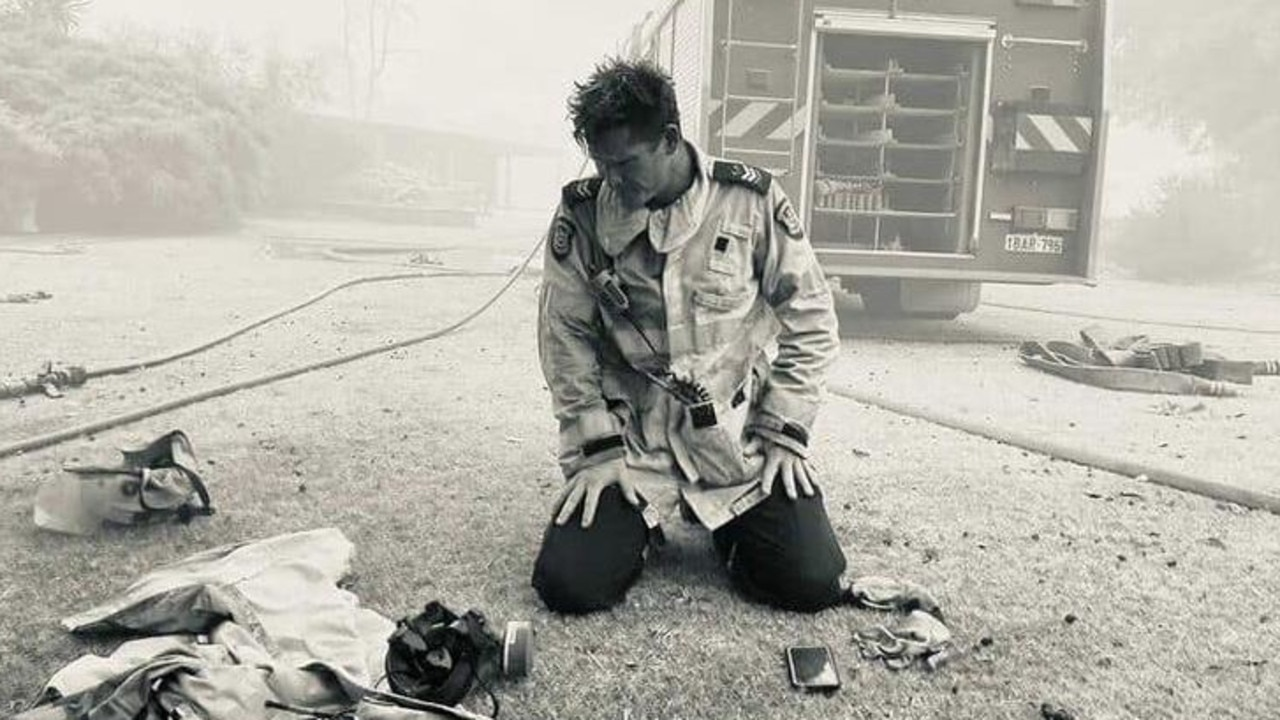 It has been a particularly rough week for firefighters in WA. Career firefighter Mick Dybac captured this moment of fellow senior firefighter David Ellis in front of a home they had just saved in the Wooroloo bushfire. Picture: Supplied by DFES via NCA NewsWire