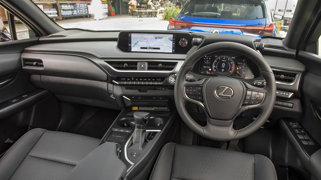 Large buttons and toggles are used in the cabin, along with a touchpad to operate the primary infotainment system.