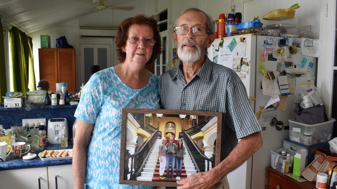 Graham Board and companion Denise Bowen at the couple's Ingham home. Mr Board is holding a photograph of daughters Jennifer and Siana taken during a holiday in Peru in 2017. Photograph: Cameron Bates