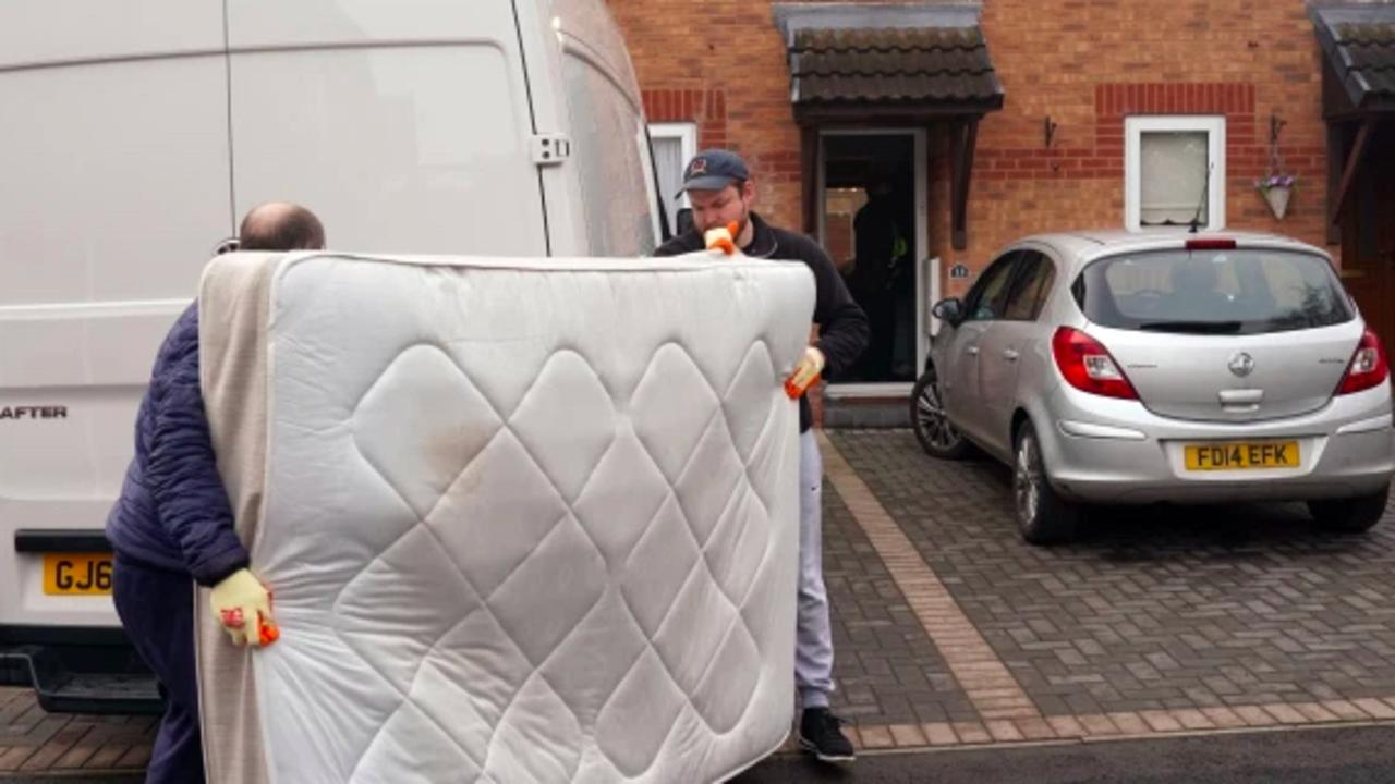 Removal people arrived at the house to take a bed away. Picture: Roland Leon