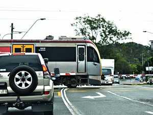 Brisbane-bound train delayed after boom gate crash