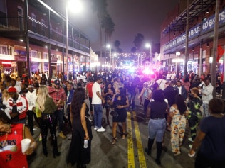 Large crowds gather in the Ybor City district on the eve Super Bowl LV on February 7, 2021 in Tampa, Florida. In addition to social distancing, the City of Tampa and the NFL have encouraged the general public to wear a mask and properly sanitise during Super Bowl weekend festivities. (Photo by Octavio Jones/Getty Images)