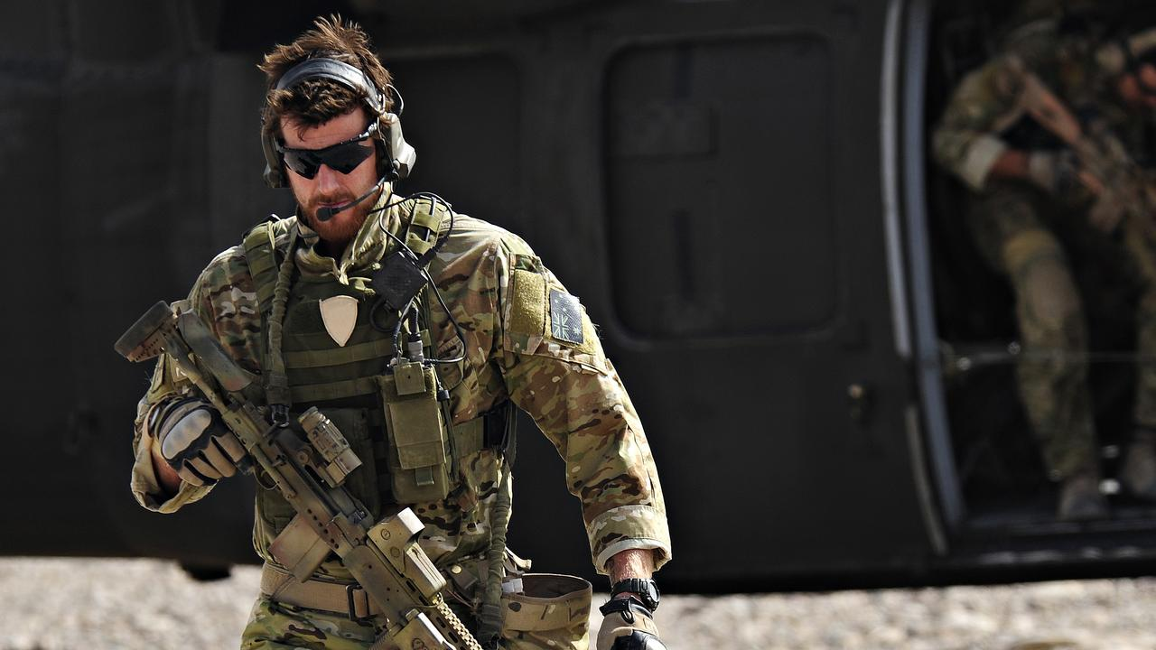 SAS Corporal Ben Roberts-Smith VC, MG, with the Australian Special Operations Task Group, leaves a UH-60 Blackhawk helicopter during preparation of the Shah Wali Kot offensive in Afghanistan in 2010. Roberts-Smith was later awarded the Victoria Cross during action in saving the lives of wounded comrades.