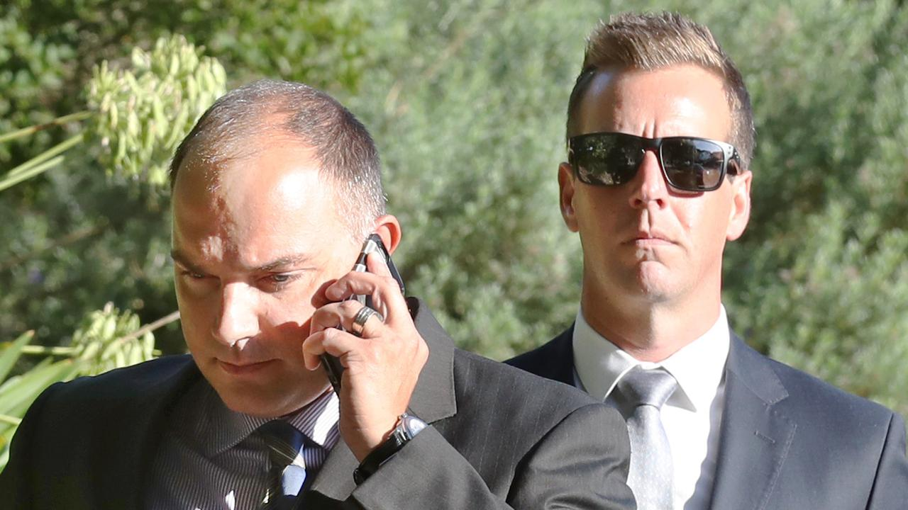 Victorian police officers Florian Hilgart and Brad McLeod arrive at the Heidelberg Magistrates' Court in March last year. They were found guilty of assault and are appealing in the County Court. Picture: AAP Image/David Crosling