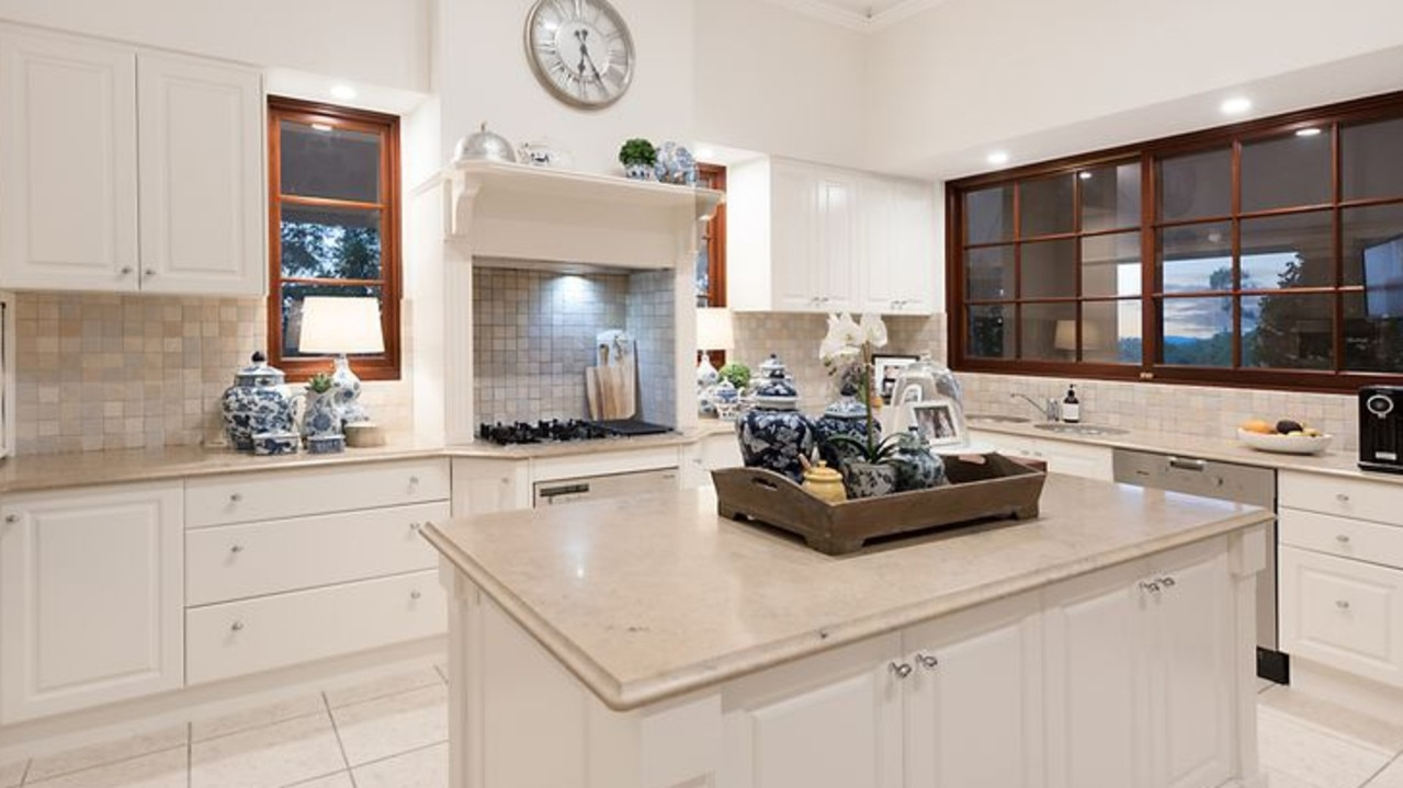 The designer kitchen is kitted out with Miele appliances.