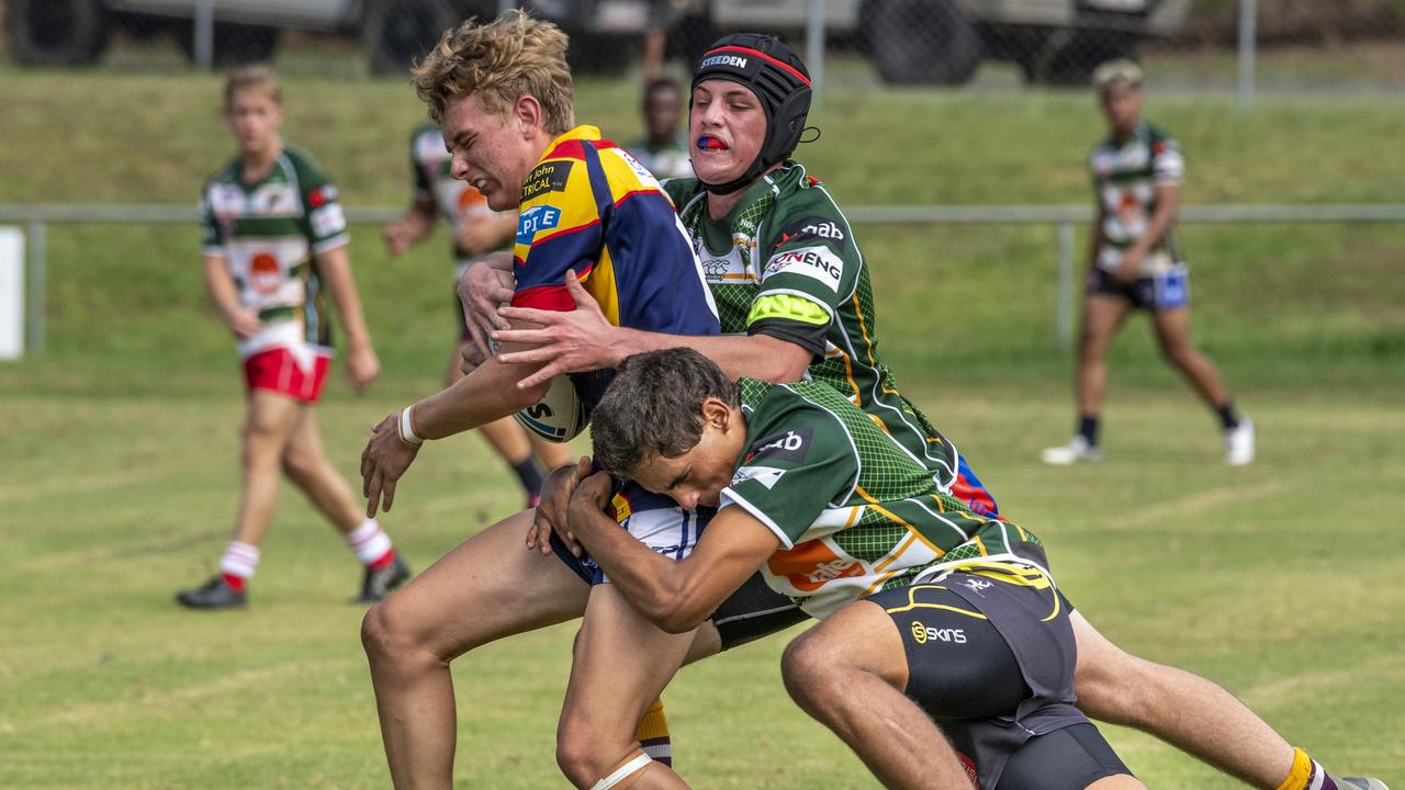 The Ipswich Jets defence work hard to halt the progress of Western Mustangs player Reily Land in their first Mal Meninga Cup trial of the new season. Picture: Nev Madsen