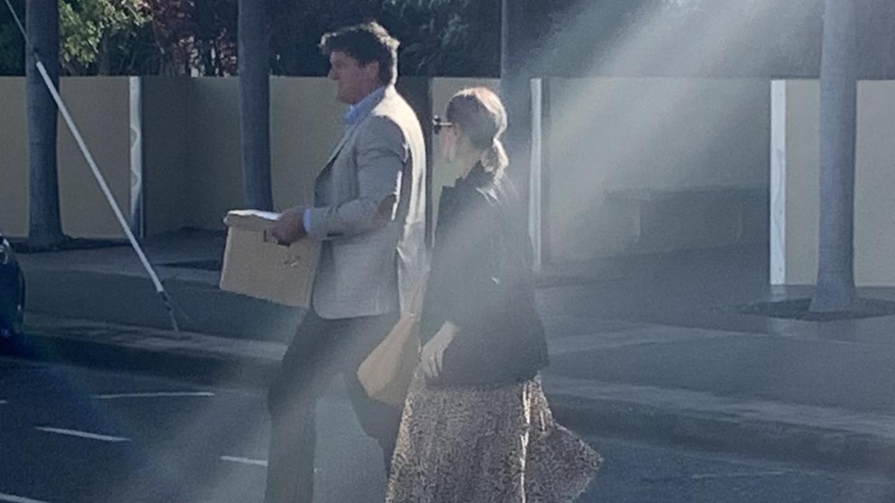 Michael and Nicole Saunders leaving Mackay courthouse after day one of a magistrates court hearing involving Whitsunday Anglican School