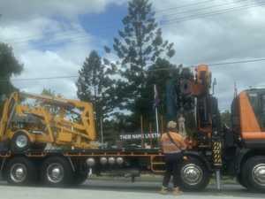 Delays follow crash involving small crane