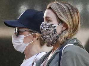 Masked Minogue sisters head to city's designer stores