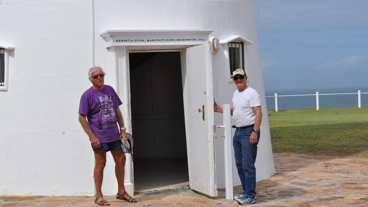Stuart Buchanan and Bustard Head lighthouse volunteer Dudley Fulton at the entrance to the lighthouse. Above the door is the name of the company that manufactured the historic lighthouse, Hennett and Spink, Bridgwater 1866.
