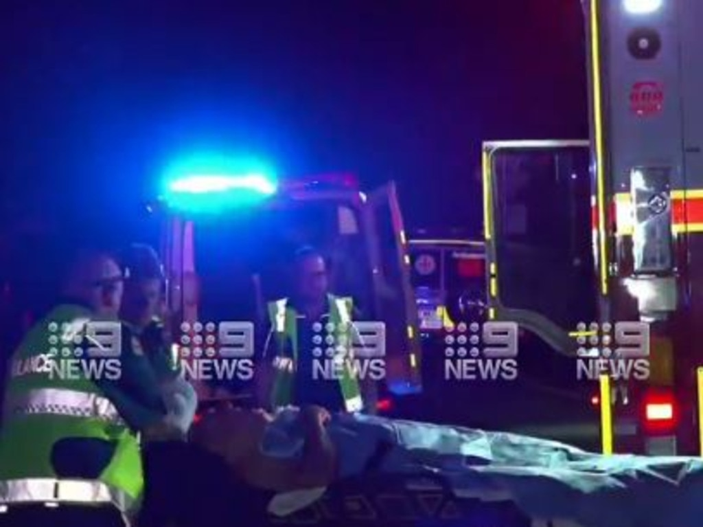 A 75-year-old motorcyclist has been found injured more than seven hours after he took a 20m fall. Picture: 9 News