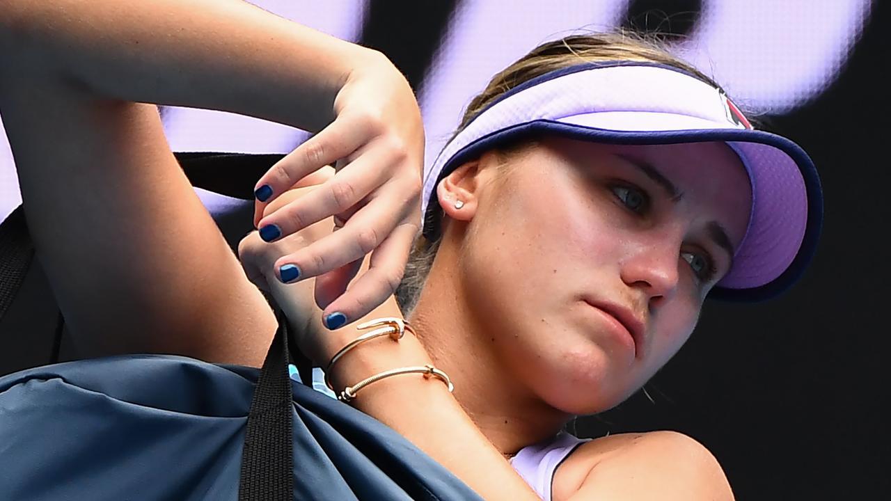 Sofia Kenin broke down in a press conference after her shock second-round loss at the Australian Open, revealing the pressure she felt as defending champion.